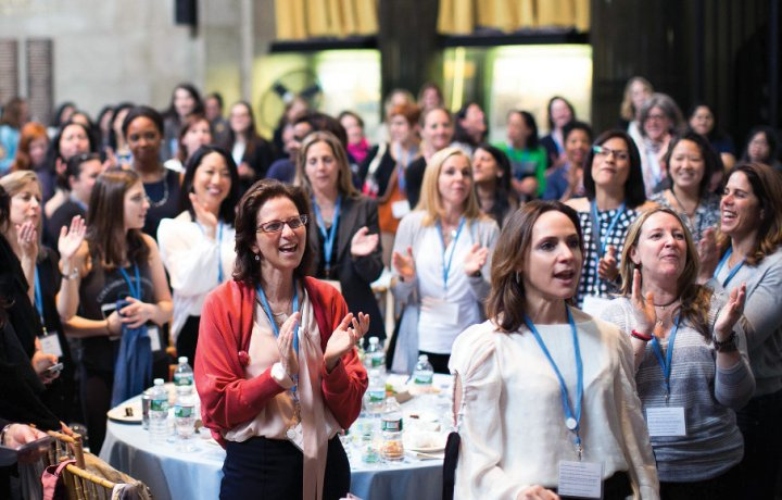 Attendees of the Columbia College Women's Symposium give a standing ovation.