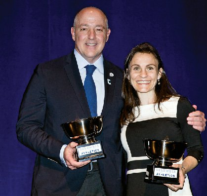 Peter Leone '83 and Rachel Flax Kaplan '03 pose together with their Athletics Alumni Awards.