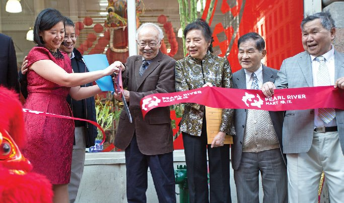 Joanne Kwong '97 and her in-laws cut the ribbon at Pearl River Mart's reopening.