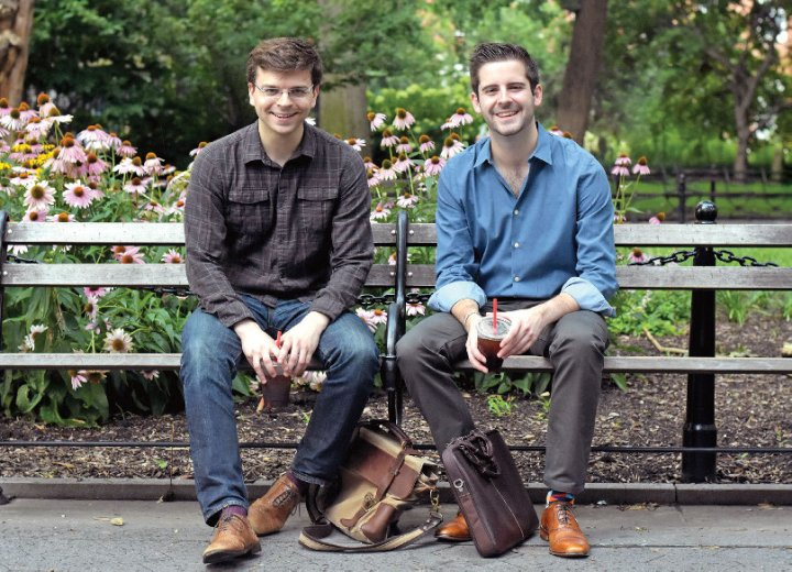 Thomas Kapusta '12 and Alexander Donnelly '14 sit together on a bench.