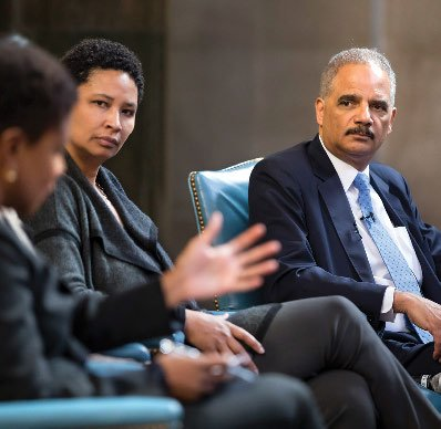 Photo of Eric Holder and other event panelists