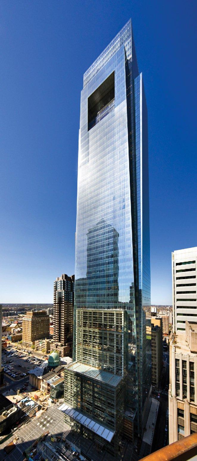 A skyscraper against a blue sky