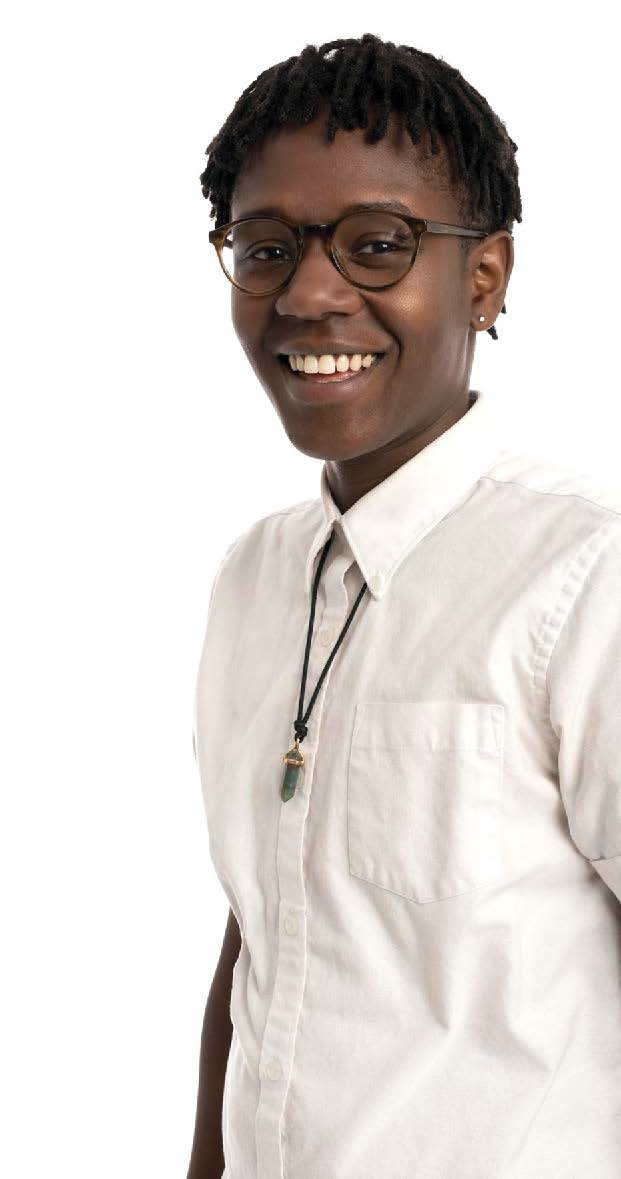 a smiling black person in a white shirt