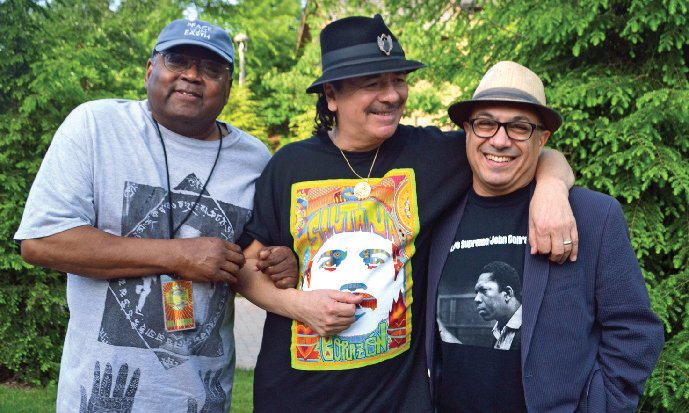 Ashley Kahn '83 (far right) with Carlos Santana (center) and Hal Miller, Kahn's co-author on Santana's 2014 memoir, backstage at a Santana gig in Woodstock, N.Y., on June 15, 2014.
