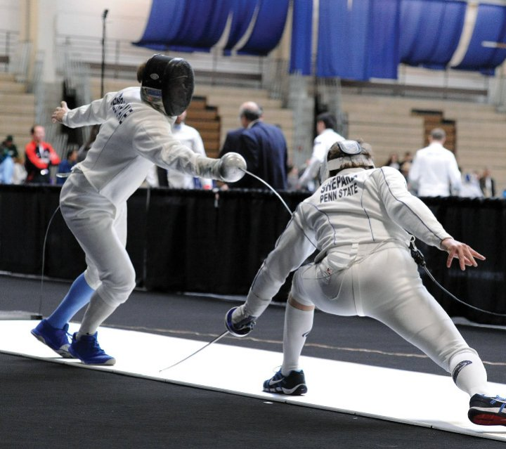 An action shot of fencers