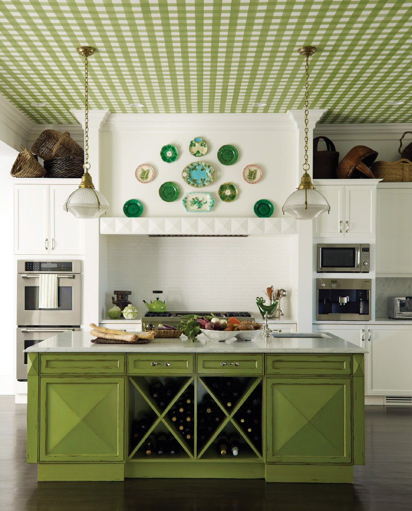 A kitchen decorated in shades and patterns of green
