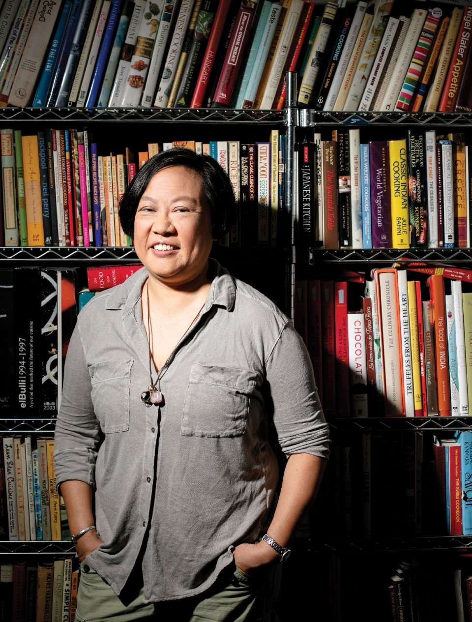 Anita Lo '88 stands in front of a bookshelf.