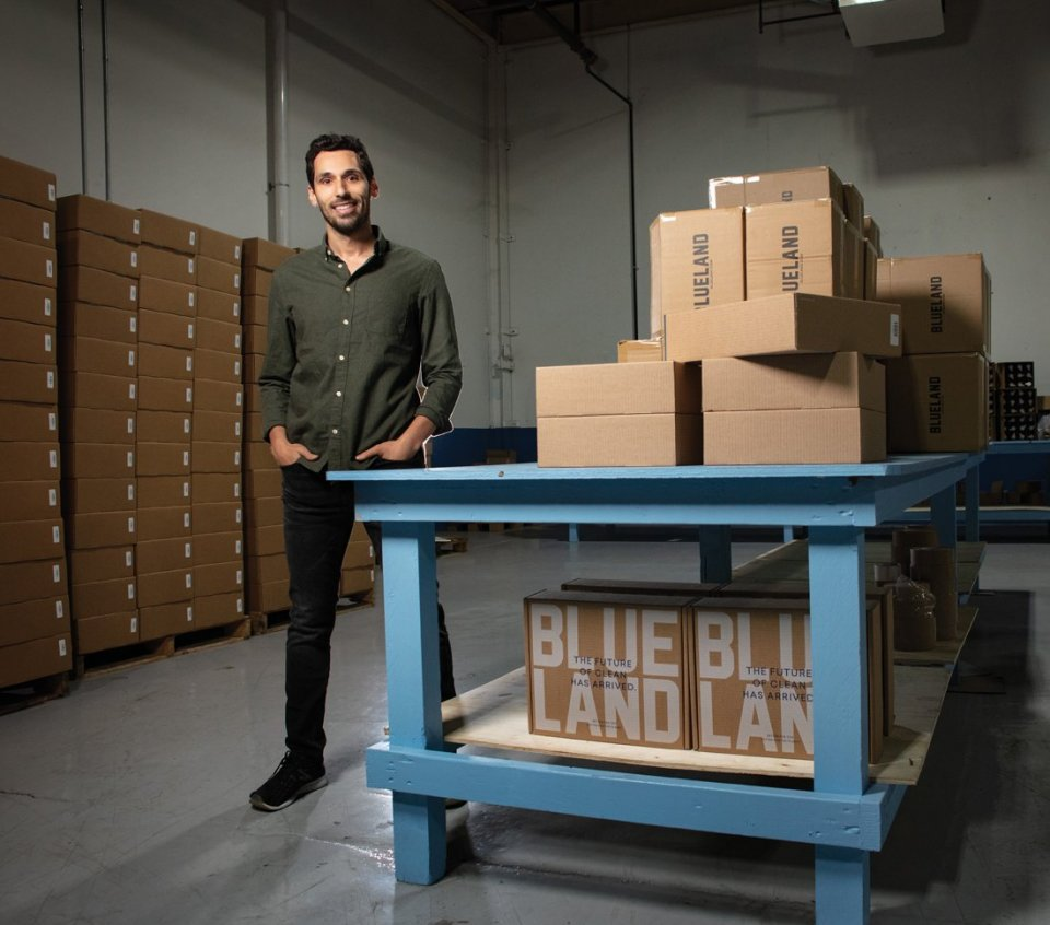 Man standing beside boxes