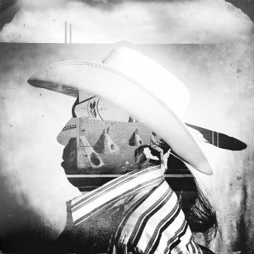 A man wearing a Stetson in profile, overlaid with a landscape