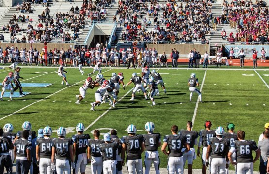 Columbia Lions football players on the field playing against University of Pennsylvania Quakers