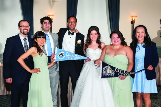 wedding party with Columbia banners