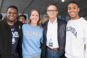 Group photo of Dean Valentini with three Columbia College alumni