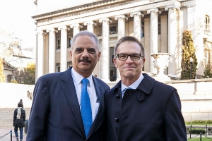Former U.S. Attorney General Eric H. Holder Jr. and Dean Valentini with Low Library in the background