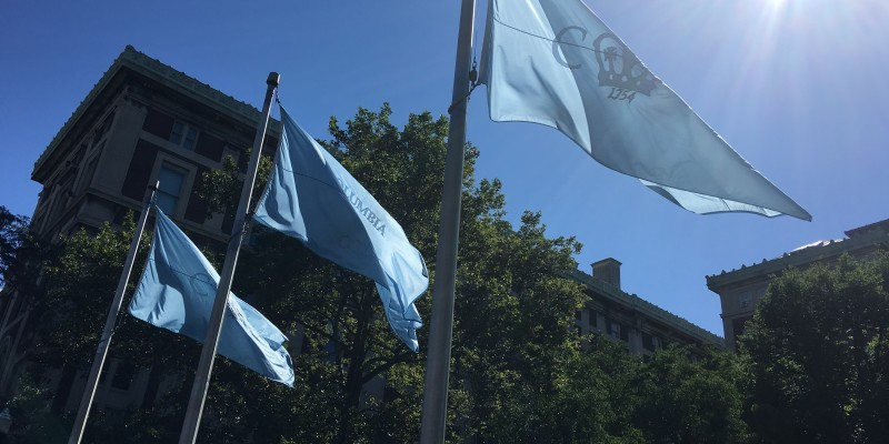 Columbia College flags in front of Hamilton Hall