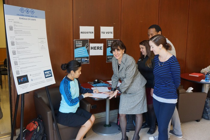 Ester Fuchs, professor of international and public affairs at SIPA, directs a group of SIPA students at one of the three voter registration tables set up by Voting Week organizers. Photo: Kevin Gully