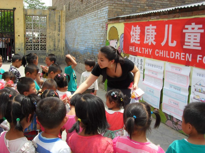 Sida Li CC '15 hands out small gifts after a health lesson. PHOTO: Courtesy Sida Li