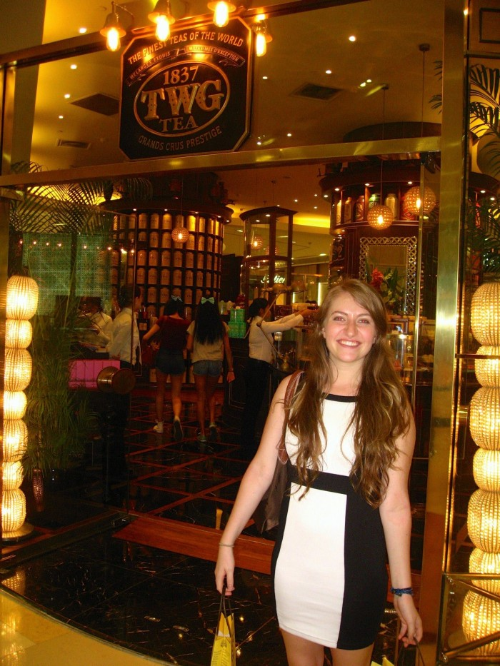 Chloé Durkin CC'15 in front of TWG Tea, the company she interned for on CEO Singapore. Photo: Courtesy Chloé Durkin CC'15