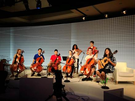 "String Theory, joined by student-musicians who had been featured on NPR's classical music program ""From the Top,"" on stage in September 2013 at Google Zeitgeist 2013 in Paradise Valley, Az. PHOTO: Courtesy String Theory"