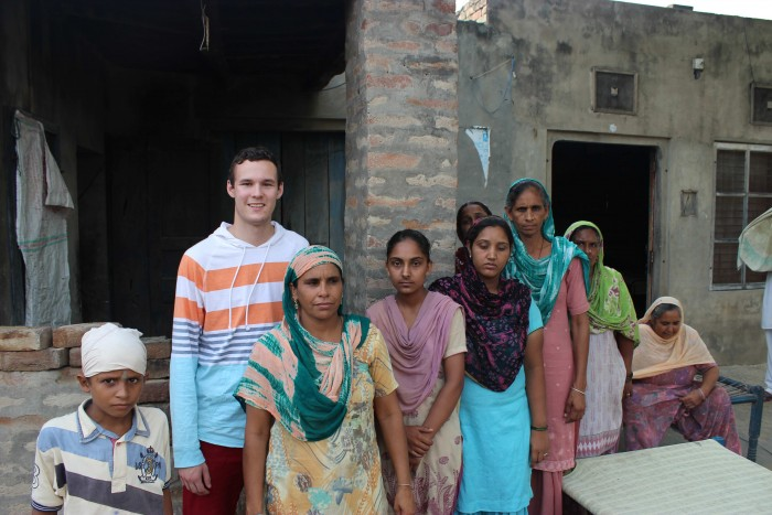 Chris Canales CC '14 with rural community members in Punjab. PHOTO: Angad Singh CC '16